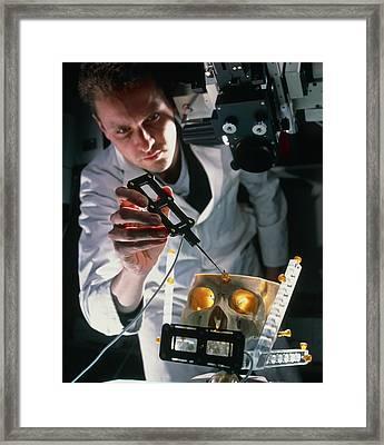 Surgeon Aligns Magi Virtual Reality Microscope Framed Print by Geoff Tompkinson