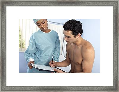 Surgery Consent Form Framed Print by Adam Gault