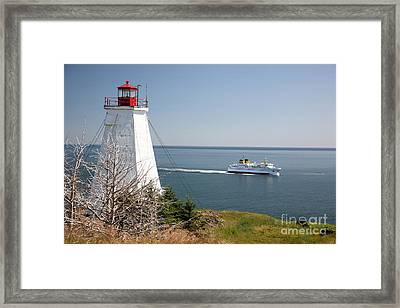 Swallowtail Lighthouse And Ferry Framed Print by Ted Kinsman