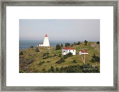Swallowtail Lighthouse Framed Print by Ted Kinsman