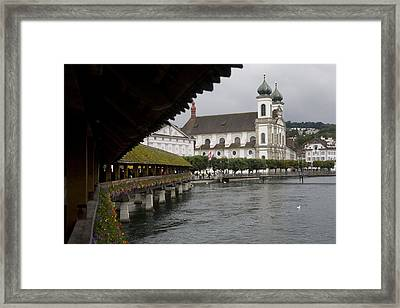 Swans Float Past The Old Town Framed Print by Taylor S. Kennedy