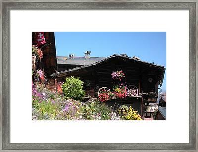 Swiss Chalet Interlaken Framed Print by Marilyn Dunlap