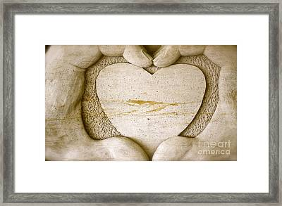 Symbol Of Love Framed Print by Ted Wheaton