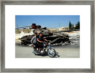 Syrian Men Drive A Motorbike Framed Print by Andrew Chittock