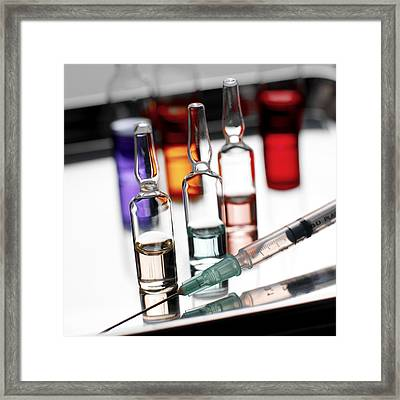 Syringe And Phials Framed Print