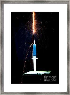 Syringe Disperses Lighting Framed Print by Guy Viner