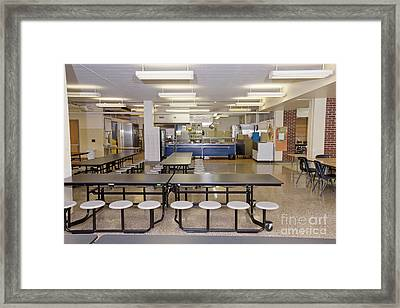 Table And Seats In A School Cafeteria Framed Print