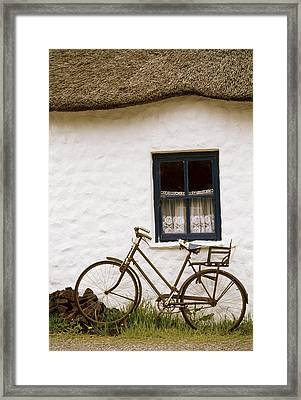 Tahtched Cottage And Bike Framed Print by Richard Cummins