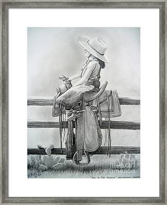 Tall In The Saddle Framed Print by Rick Mittelstedt