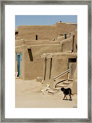 Taos Pueblo Framed Print by Stellina Giannitsi