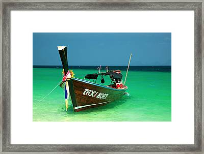 Taxi Boat Framed Print by Adrian Evans