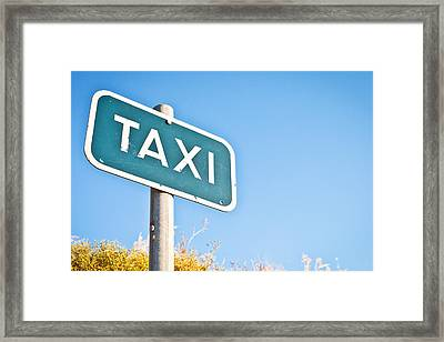 Taxi Sign Framed Print by Tom Gowanlock