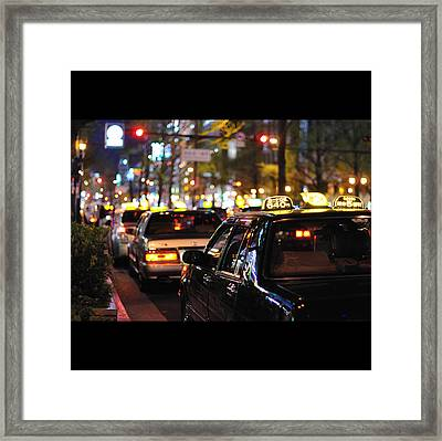 Taxis On Street At Night Framed Print