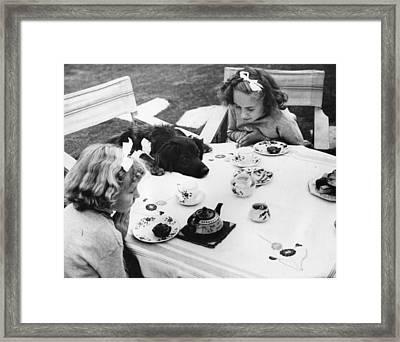 Tea Party Framed Print by Fox Photos