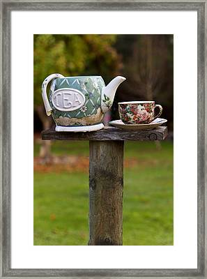 Teapot And Tea Cup On Old Post Framed Print