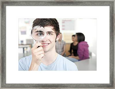 Teenage Boy With Magnifying Glass Framed Print by