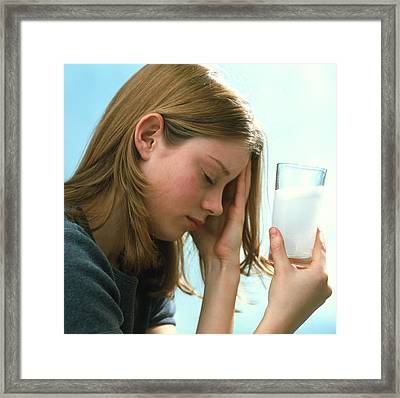 Teenager With Headache Holds Dissolving Painkiller Framed Print