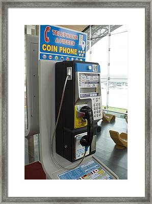 Telephone In Airport Lounge Framed Print by Mark Williamson