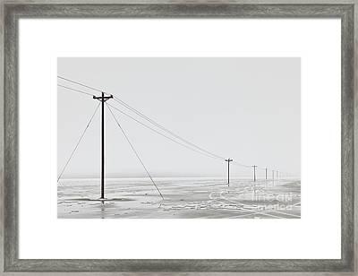 Telephone Poles In Bleak Winter Landscape Framed Print by Dave & Les Jacobs