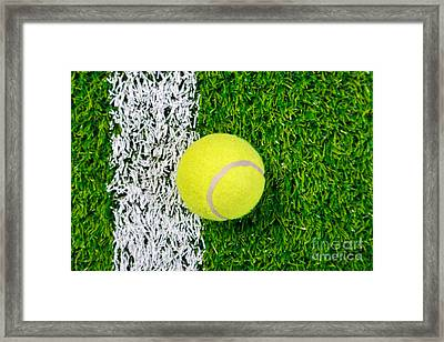 Tennis Ball On Grass From Above. Framed Print by Richard Thomas