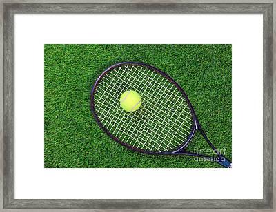 Tennis Raquet And Ball On Grass Framed Print by Richard Thomas