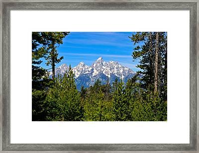 Teton Window Framed Print by Greg Norrell