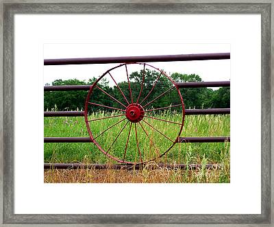 Framed Print featuring the photograph Texas Wildflowers Through Wagon Wheel by Kathy  White