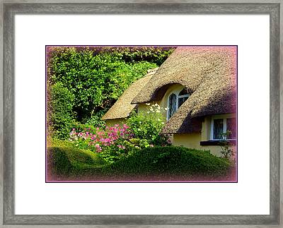 Thatched Cottage With Pink Flowers Framed Print