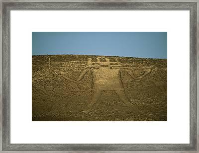 The 282-foot-tall El Gigante Geoglyph Framed Print by Joel Sartore