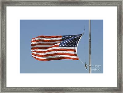 The American Flag Waves At Half-mast Framed Print by Stocktrek Images