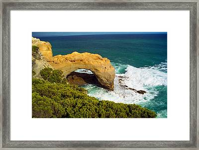 Framed Print featuring the photograph The Arch With Breaking Wave by Dennis Lundell