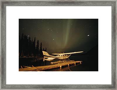 The Aurora Borealis Glows Brightly Framed Print