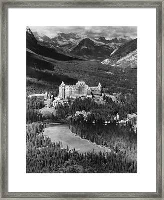 The Banff Springs Hotel In The Bow Framed Print by Everett