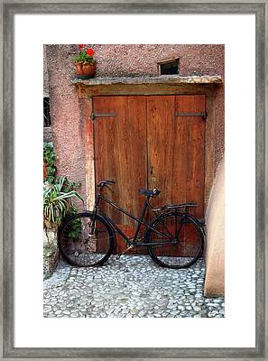 The Bicycle Framed Print by Emanuel Tanjala