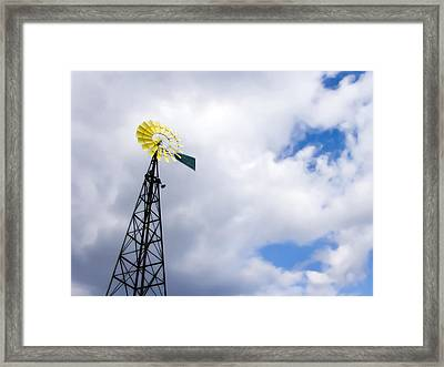The Blades Of A Windmill Are Painted Framed Print