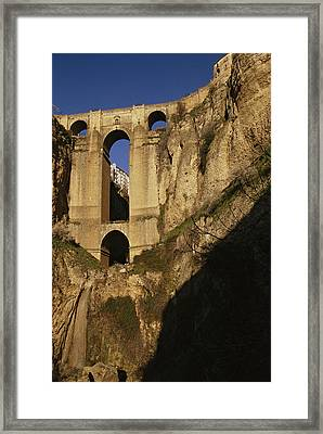The Bridge At Ronda Spain Connects Framed Print by Stephen Alvarez