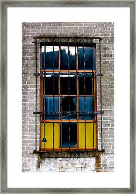 The Broken Window Framed Print