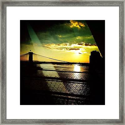 The Brooklyn Bridge At Dusk Framed Print