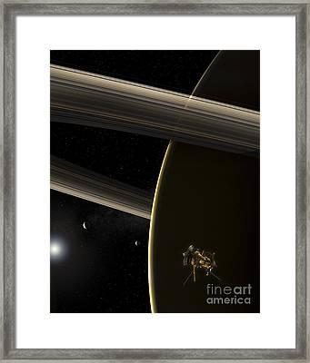 The Cassini Spacecraft In Orbit Framed Print by Steven Hobbs