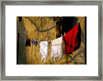 The Clothes Framed Print by Odon Czintos