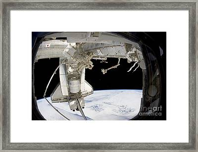 The Docked Space Shuttle Discovery Framed Print