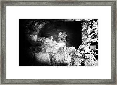 The Dwelling In The Cliff Framed Print by John Rizzuto
