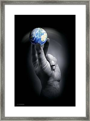 The Earth Held By A Human Hand Framed Print by Detlev Van Ravenswaay