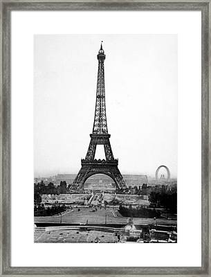 The Eiffel Tower With The Great Wheel Framed Print by Everett