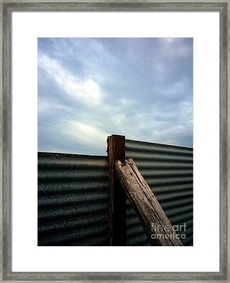 The Fence The Sky And The Beach Framed Print