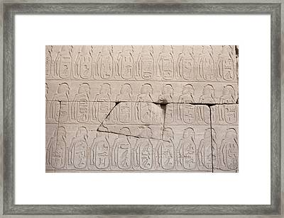 The Figures Of Prisoners On A Temple Framed Print by Taylor S. Kennedy