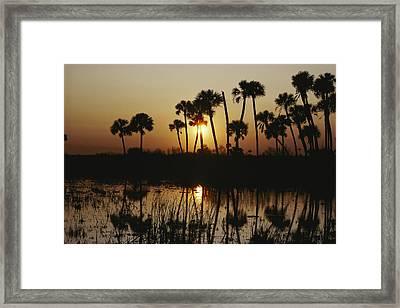 The Flaming Orange Sun Sets Framed Print