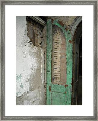 Framed Print featuring the photograph The Green Door by Christophe Ennis
