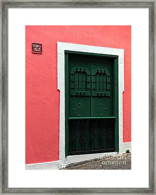 The Green Door Framed Print by John Rizzuto