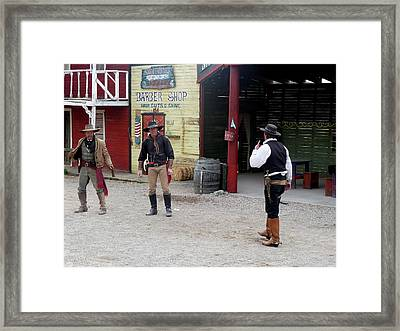 The Gunfight Framed Print